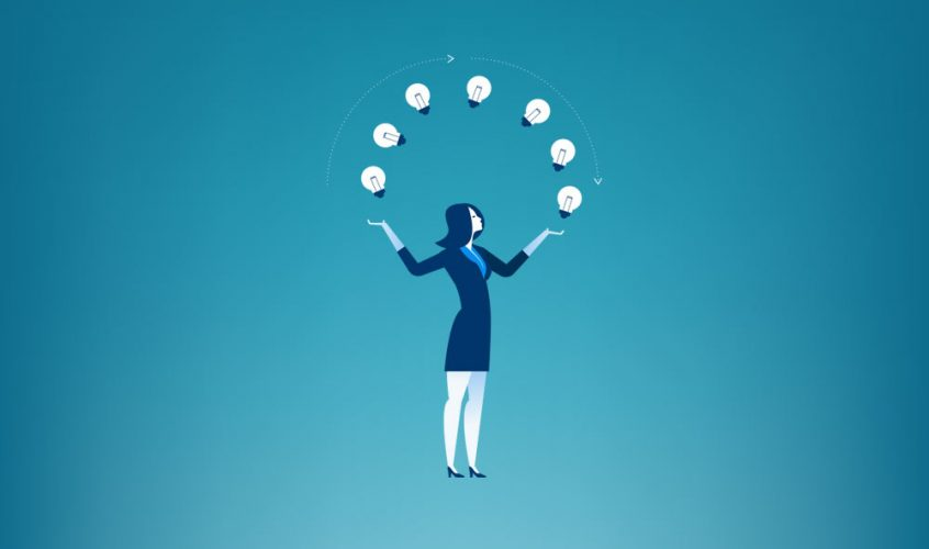 Successful woman juggling lightbulbs