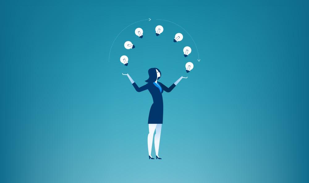 Successful woman juggling lightbulbs
